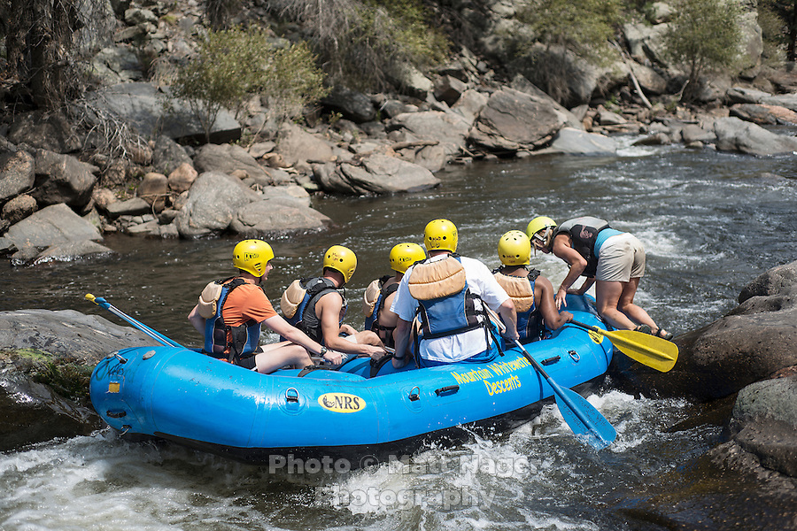 Rafters with Mountain Whitewater Descents get stuck between rocks on the Cache Le Poudre River near Fort Collins, Colorado, Friday, August 24, 2012. The worst drought since the 1950s is ricocheting through the economy, hitting everything from tractor sales in the Midwest to the ability of rafting companies in Colorado to run summer tours on low rivers.<br /> <br /> Photo by MATT NAGER