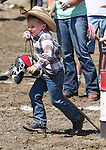 Jace Nelson of Fallon competes in the Pee-Wee Stick Horse Barrel race event at the Fallon Junior Rodeo.  Photo by Tom Smedes.