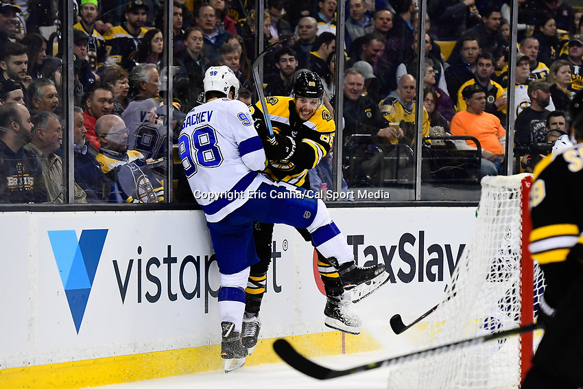March 29, 2018: Boston Bruins right wing David Pastrnak (88) is checked by Tampa Bay Lightning defenseman Mikhail Sergachev (98) during the NHL game between the Tampa Bay Lightning and the Boston Bruins held at TD Garden, in Boston, Mass. Boston defeats Tampa Bay 4-2. Eric Canha/CSM