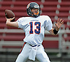 Manhasset quarterback No. 13 Connor Barrett throws a pass during the first quarter of a Nassau County Conference II varsity football game against host Garden City High School on Saturday, September 12, 2015. Garden City won by a score of 38-14.<br /> <br /> James Escher