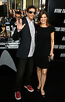 """HOLLYWOOD, CA. - April 30: Perrey Reeves and guest arrive at the Los Angeles premiere of """"Star Trek"""" at the Grauman's Chinese Theater on April 30, 2009 in Hollywood, California.a"""