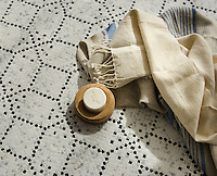 Augustine, a hand-cut stone mosaic, shown in hand-chopped tumbled Calacatta Tia and Nero Marquina, was designed by Paul Schatz as part of the Legend collection for New Ravenna.