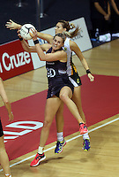 28.07.2015 Silver Ferns Leana de Bruin and South Africa's Lenize Potgieter in action during the Silver Fern v South Africa netball test match played at Trusts Arena in Auckland. Mandatory Photo Credit ©Michael Bradley.