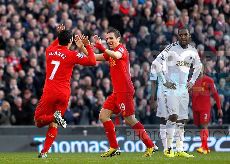 Luis Suarez (L) of Liverpool celebrates his goal with team mate Stewart Downing (C) - Barclays Premier League - Everton vs Swansea City - Anfield Stadium - Liverpool - England - 17th February 2013