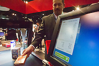00091686 New York, New York.  1/16/2012 NATIONAL RETAIL FEDERATION TRADE SHOW.  The Wincor Nixdorf, a product scanner for self-checkout, seen at their booth at the annual National Retail Federation trade show at the Jacob Javits Convention Center in New York    FRANCES ROBERTS/FREELANCE PHOTOGRAPHER