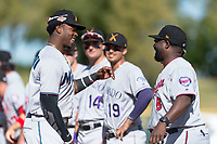 Salt River Rafters center fielder Monte Harrison (4), of the Miami Marlins organization, prepares to give manager Tommy Watkins (8) a hug during player introductions before the Arizona Fall League Championship game against the Peoria Javelinas at Scottsdale Stadium on November 17, 2018 in Scottsdale, Arizona. Peoria defeated Salt River 3-2 in extra innings. (Zachary Lucy/Four Seam Images)