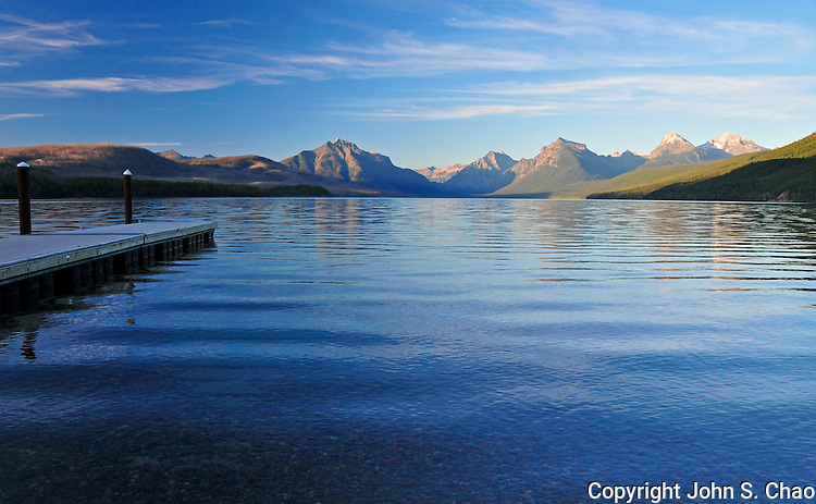 Sunrise view from Apgar boat dock of Lake McDonald in Glacier National Park, Montana.