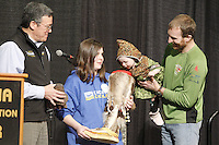 Thursday February 28, 2013  14th month old Rosie Maximer, daughter of musher Kelley Maximer picks her fathers starting number from a mukluk held by Hannah O'Toole, a child from the Make a Wish Foundation and sponsored by Donlin Gold, whose General Manager Stan Foo looks on at the musher drawing banquet held at the Dena'ina Convention Center in Anchorage two days prior to the start of Iditarod 2013...Photo (C) Jeff Schultz/IditarodPhotos.com  Do not reproduce without permission.