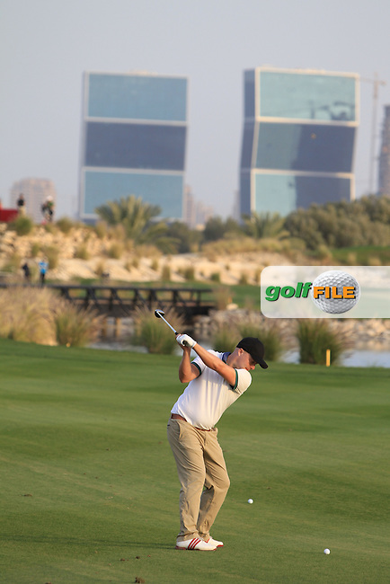 Peter Erofejeff (FIN) in action on the 15th hole during Monday's Practice Day of the Commercial Bank Qatar Masters 2013 at Doha Golf Club, Doha, Qatar 21st January 2013 .Photo Eoin Clarke/www.golffile.ie