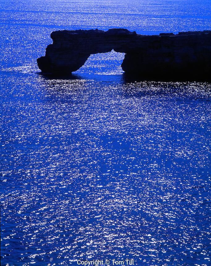Sea arch on Crete Coast,  Greece  Sea of Crete  Aegean Sea Limestone cliffs along North Coast