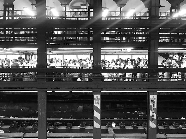 Commuters waiting for the subway at Union Square in New York City on August 16, 2017.