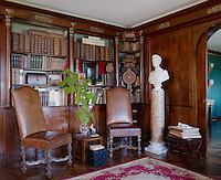 The library is panelled in mahogany inset with gilt ormolu