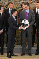 King Felipe VI of Spain receives a helmet from moto rider Marc Marquez during Royal Audience at Zarzuela Palace in Madrid, Spain. November 20, 2014. (ALTERPHOTOS/Victor Blanco) /NortePhoto.com<br />