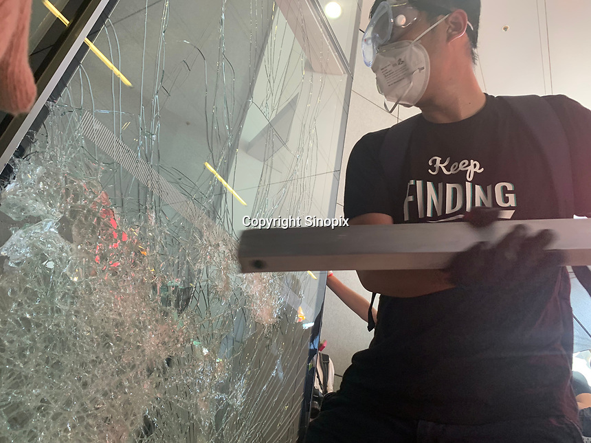 Mostly student and youth demonstrators break into the Hong Kong's Legislative Council Chamber 1st July 2019. The protestors caused widespread damage and are demonstrating against the extradition bill, since suspended, that was being pushed through the Hong Kong Council.