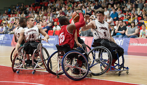 03.07.2016. Leicester Sports Arena, Leicester, England. Continental Clash Wheelchair Basketball, England versus Canada. Ade Orogbemi (GBR) fights to keep the ball from opponents Ben Moronchuk (CAN) and Vincent Dallaire (CAN)