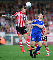 Lincoln City's Harry Anderson vies for possession with Tranmere Rovers' Connor Jennings<br /> <br /> Photographer Chris Vaughan/CameraSport<br /> <br /> The EFL Sky Bet League Two - Lincoln City v Tranmere Rovers - Monday 22nd April 2019 - Sincil Bank - Lincoln<br /> <br /> World Copyright © 2019 CameraSport. All rights reserved. 43 Linden Ave. Countesthorpe. Leicester. England. LE8 5PG - Tel: +44 (0) 116 277 4147 - admin@camerasport.com - www.camerasport.com