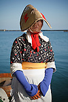 Sado island, August 2010 - Woman in traditional Sado dress at Ogi port, waiting for the tourists to get in their taraibune, traditional tub boat.