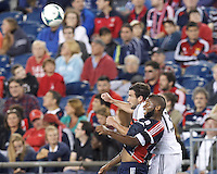 New England Revolution defender Andrew Farrell (2) and D.C. United midfielder Chris Pontius (13) battle for head ball.  In a Major League Soccer (MLS) match, the New England Revolution (blue) defeated D.C. United (white), 2-1, at Gillette Stadium on September 21, 2013.
