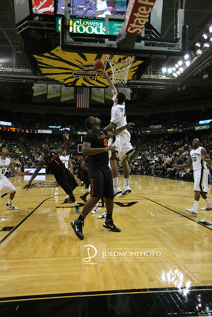 Wake Forest Demon Deacons center Ty Walker (40) makes a block  on a shot by Miami (Fl) Hurricanes guard Durand Scott (1). Miami wins a close one in the final seconds 74-73.