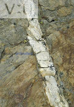 Quartz vein in metamorphic rock, California, USA.