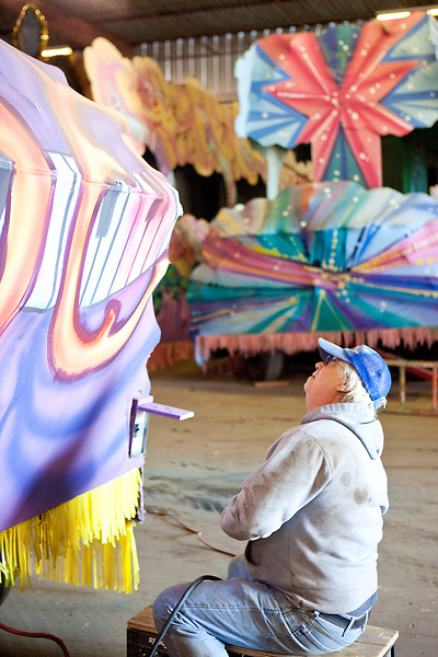 "John Ranna, self described ""All-Purpose Guy"", fixes wiring on a Mardi Gras float at Barry Barth (Artists and Designers), in New Orleans on February 2, 2010."