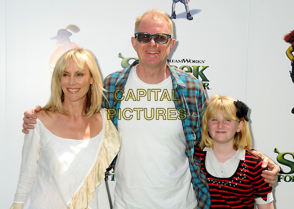 "RACHELLE CARSON, ED BEGLEY JR. & HAYDEN CARSON.""Shrek Forever After"" Los Angeles Premiere held at the Gibson Amphitheatre, Universal City, California, USA..May 16th, 2010.half length white cream top blue check shirt sunglasses shades married husband wife red black striped stripes daughter mother mom mum father dad family.CAP/ADM/BP.©Byron Purvis/AdMedia/Capital Pictures."