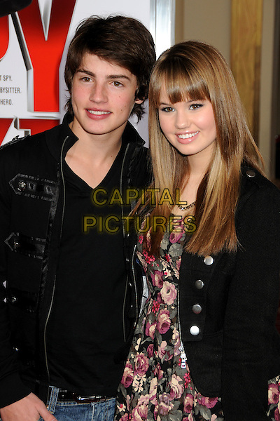 "GREGG SULKIN & DEBBY RYAN .""The Spy Next Door"" Los Angeles Premiere held at The Grove,  Los Angeles, California, USA, .9th January 2010..half length black jacket pink red floral pattern print dress .CAP/ADM/BP.©Byron Purvis/Admedia/Capital Pictures"