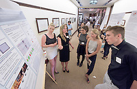 """From left, Elizabeth Seibert '16 and Alyssa Sanchez '16 present their project, """"Neural Correlates of Emotional Processing"""" to Lisa Najarian '16, Caitlin Lingelbach '16 and  Ed Sartor '17. After researching all summer, Occidental College students present their work at the annual Summer Undergraduate Research Conference on July 29, 2015.<br /> (Photo by Marc Campos, Occidental College Photographer)"""