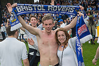 Bristol Rovers fans celebrate promotion after the Sky Bet League 2 match between Bristol Rovers and Dagenham and Redbridge at the Memorial Stadium, Bristol, England on 7 May 2016. Photo by Mark  Hawkins / PRiME Media Images.