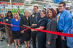 Politicians, business leaders, and store employees cut the ribbon inside the Walmart in Westerville, Ohio, for the store's grand opening.