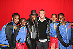 One Life to Live's Tika Sumpter poses with figure skaters from Harlem at the 2009 Skating with the Stars - a benefit gala for Figure Skating in Harlem on April 6, 2009 at Wollman Rink, Central Park, NYC, NY. (Photo by  Sue Coflin/Max Photos)
