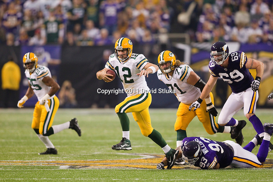 Green Bay Packers quarterback Aaron Rodgers (12) escapes a pass rush during a Week 7 NFL football game against the Minnesota Vikings on October 23, 2011 in Minneapolis, Minnesota. The Packers won 33-27. (AP Photo/David Stluka)