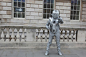 London, UK. 27 April 2014.  Man in a Cyberman costume from Doctor Who. Sci-Fi fans gathered in the Courtyard of Somerset House, London, and dressed up as their favourite science fiction character ahead of a parade through London. This 4th annual parade was organised by Sci-Fi London 14, the London International Festival for Science Fiction and Fantastic Film which runs unil May 4th.