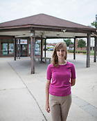 Katie Spencer, The Executive Director of The Museum of Durham History, outside the former Durham Bus Depot and future location of the Durham History Hub, Monday, July 16, 2012.