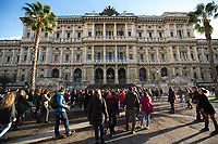 """WARNING, SOME PHOTOS CONTAIN NUDITY.<br /> <br /> Rome, 07/12/19. Hundreds of women held a flash mob (1.) outside the Supreme Court of Cassation performing the song-performance """"Un violador en tu camino"""" of the Chilean feminist group Las Tesis. The aim of the flash mob was to protest gender-based violence against women, feminicides (Femminicidio), against patriarchy. Same flash mob were held in numerous cities across the globe, including Barcelona, Madrid, Oviedo, Paris, London, Bristol, Berlin, Bogotà, Mexico City. From an article published on the Manifesto newspaper (2.): «[…] Since the song was sung in a flash mob at the Plaza de Armas in Valparaíso, during the World Day Against Violence against Women of 25 November [3.], that same indictment directed against the State, against the system, against the agents of (in)security has always been repeated with the same powerful choreography in several Chilean cities, […]""""Patriarchy is a judge who judges us for being born. And our punishment is this violence"""", the women shout, pointing the finger, afterwards, against the policemen (los pacos, as they are popularly called in Chile), the judges, the state, the president (""""Y la culpa no era mía, ni dónde estaba ni cómo vestía. El violador eres tú""""). Of great impact in every place, the song, inspired by the texts of the Argentine Rita Segato (the one who gave life in Bolivia to the bitter feminist debate around the government of Evo Morales), naturally acquires a particular meaning in Chile, […] It is no coincidence that there were 88 complaints of sexual violence presented mainly against the carabineros, which are also explicitly called into question in the song where, by contrast, a fragment of their hymn that describes them in the act of supervising the """"sweet sleep"""" of the """"innocent girls""""».<br /> <br /> Footnotes & Links:<br /> 1.http://bit.do/fj2fD<br /> 2.(ilManifesto.it) http://bit.do/fj2fN<br /> 3.http://bit.do/fj2ms<br /> Video (laRepubblica.it) http://bit.do/fj2hw"""