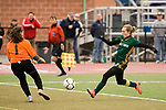 MIDDLETOWN, CT-111817JS24- Holy Cross' Erin Goggin (3) fires a shot that went wide, past Old Lyme's Emily RIvera (1), during their Class S state final game Saturday at Middletown High School.<br /> Jim Shannon Republican-American