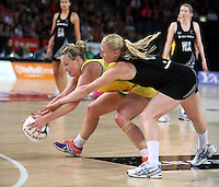 20.09.2012 Silver Ferns Laura Langman and Australian Kim Green in action during the second netball test match between the Silver Ferns and the Australian Diamonds played at Vector Arena in Auckland. Mandatory Photo Credit ©Michael Bradley.