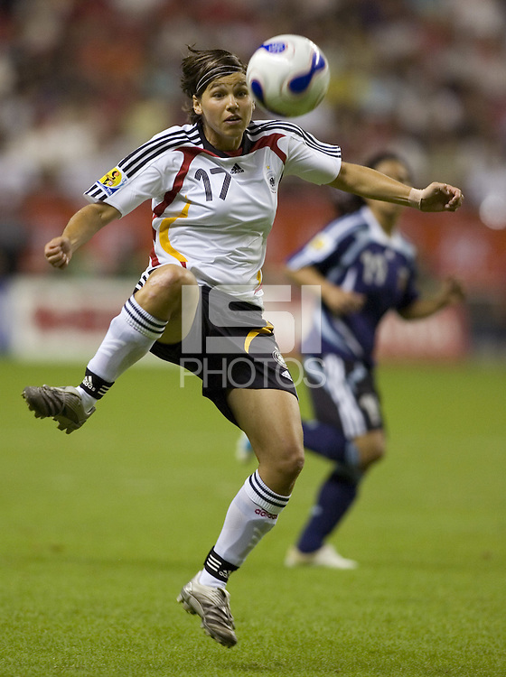 Germany defender (17) Ariane Hingst.  Germany (GER) defeated Argentina (ARG) 11-0 during an opening round Group A match of the FIFA Women's World Cup China 2007 at Shanghai Kongkou Football Stadium, Shanghai, China, on September 10, 2007.