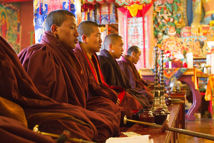 Monks chanting duing our Puja ceremony. Photo by Didrik Johnck.