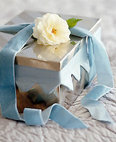 A memory box lined with fabric and decorated with a matching velvet ribbon