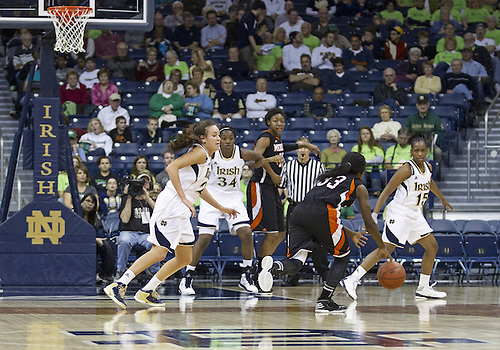 November 20, 2012:  A general view as Mercer guard Precious Bridges (33) dribbles the ball and Notre Dame guard Michaela Mabrey (23) defends during NCAA Women's Basketball game action between the Notre Dame Fighting Irish and the Mercer Bears at Purcell Pavilion at the Joyce Center in South Bend, Indiana.  Notre Dame defeated Mercer 93-36.