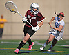 Quinn Lacy #1, North Shore goalie, left, circles behind the net during the Nassau County varsity girls lacrosse Class B quarterfinals against host Long Beach High School on Thursday, May 19, 2016. Long Beach won 9-8 in overtime.