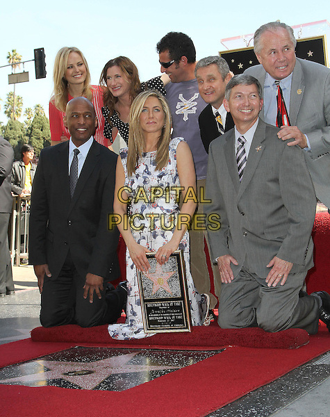 Malin Ackerman, Jennifer Aniston, Kathryn Hahn and Adam Sandler.Jennifer Aniston is honored with a Star on the Hollywood Walk of Fame on Hollywood Blvd., Hollywood, California, USA..February 22nd, 2012.full length white blue print dress grey gray suit black kneeling plaque .CAP/ADM/KB.©Kevan Brooks/AdMedia/Capital Pictures.