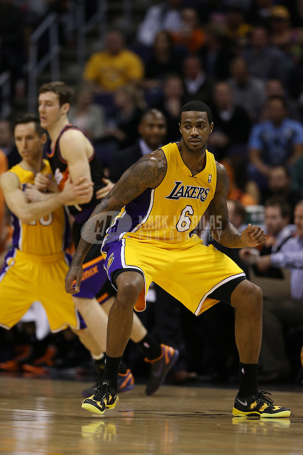 Jan. 30, 2013; Phoenix, AZ, USA: Los Angeles Lakers forward Earl Clark (6) against the Phoenix Suns at the US Airways Center. Mandatory Credit: Mark J. Rebilas-