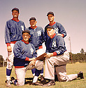 New York Giants Coaching Staff (19) portrait from the 1958 season(standing L to R) Ken Kavanaugh, John Dell Isola, Tom Landry. Kneeling VInce Lombardi and John Lee Howell.(SportPics)