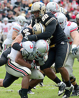 Purdue defensive end Ryan Kerrigan (94) and defensive tackle Mike Neal (92) make a tackle on Ohio State running back Brandon Saine (3). The Purdue Boilermakers defeated the Ohio State Buckeyes 26-18 at Ross-Ade Stadium, West Lafayette, Indiana on October 17, 2009..