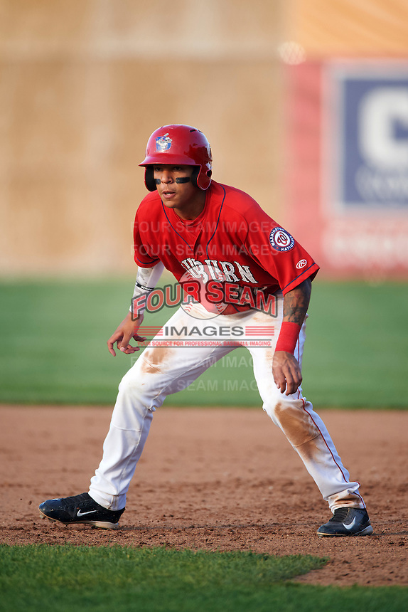 Auburn Doubledays designated hitter Andres Martinez (32) leads off first during a game against the Mahoning Valley Scrappers on June 19, 2016 at Falcon Park in Auburn, New York.  Mahoning Valley defeated Auburn 14-3.  (Mike Janes/Four Seam Images)