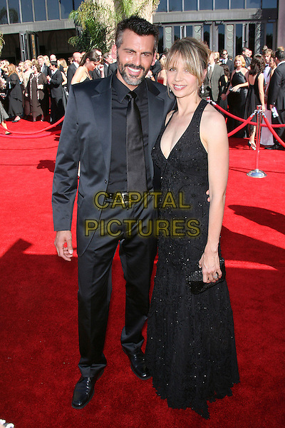 ODED FEHR & GUEST.Red Carpet Arrivals - 58th Annual Primetime Emmy Awards held at the Shrine Auditorium,  Los Angeles, California, USA, 27 August 2006..full length black dress beard emmys .Ref: ADM/ZL.www.capitalpictures.com.sales@capitalpictures.com.©Zach Lipp/AdMedia/Capital Pictures.