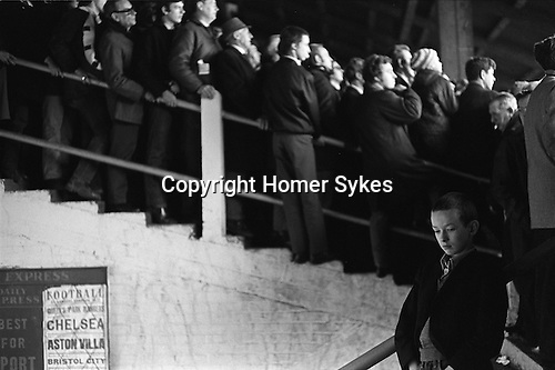 Young skinhead not watching the football in the Shed at Chelsea Football ground. London