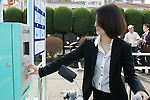 "March 16, 2010 - Tokyo, Japan - A woman enters the new Solar Parking Lots in Sentaya, Tokyo, Japan, with an electric hybrid bicycle ""eneloop"" on March 16, 2010. Completed by Sanyo Electric, the ""Solar Parking Lot"" incorporates solar panels and lithium-ion battery systems, and provision of 100 electric hybrid bicycles. (Photo Laurent Benchana/Nippon News)"